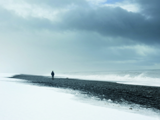 Alone man standing on the dark nordic beach in Iceland - thinking, loneliness concept photo ; Shutterstock ID 610739141; Purchase Order: -