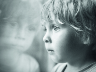 Little boy looking through window.; Shutterstock ID 154732991; Purchase Order: -