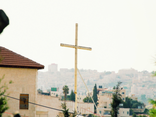 Wooden cross with Jerusalem housing in the distance; Shutterstock ID 1419373955; Purchase Order: -