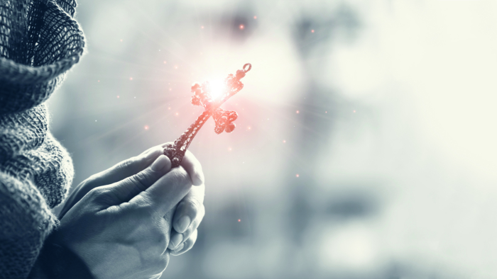 Christianity woman with christian cross in hands praying for blessing and hope from god. ; Shutterstock ID 1383373610; PO Number - Raise a BBC PO Using Vendor No. 1150465: -; Employee Email: -