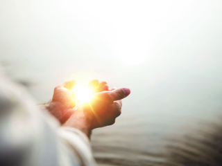 A beautiful shot of Jesus Christ holding hope and light in his palms with a blurred background; Shutterstock ID 1540652960; Project: -