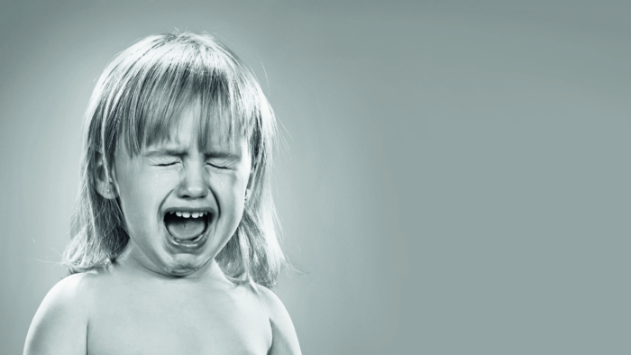 Portrait of a little girl. She is crying; Shutterstock ID 382312555; Purchase Order (valid Channel 5 PO only): -