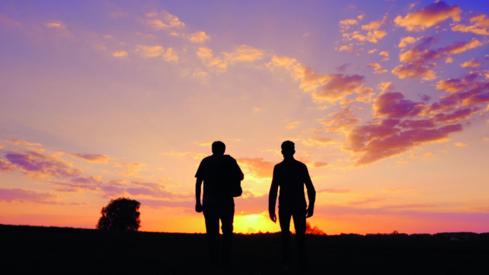 Silhouettes of two men - son and father go together to meet the sunset. Back view.; Shutterstock ID 1071227588; Purchase Order: purchase_order